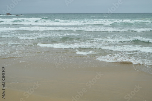 фотография  Waves Breaking With White Sand On The Beach Of El Aguilar On A Rainy Day