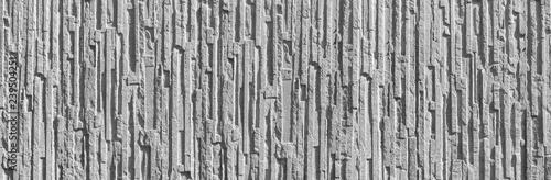 Panorama einer groben grauen Wand mit einem Relief aus Sichtbeton im Sonnenlicht Canvas Print