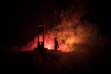 Horror View Of Guillotine. Close-up Of A Guillotine On A Dark Foggy Background.
