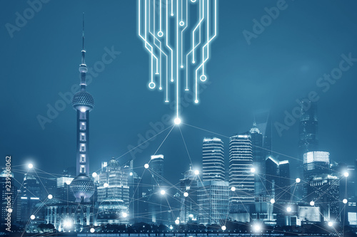 Technology connection in the big city network business concept. The background is Shanghai City skyline unban view at night.