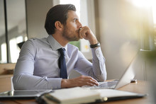 Handsome Businessman In Modern Office Looking Out