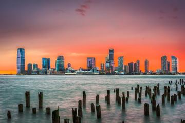 FototapetaJersey City, New Jersey, USA skyline on the Hudson River just after sunset.
