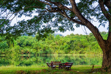 Set Of Garden Table Beside The Natural Lake.