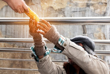 Hand Homeless Man And Bread.