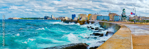 The Havana skyline and the iconic Malecon seawall with a stormy ocean