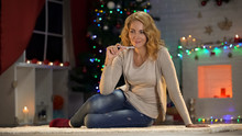 Young Beautiful Lady Writing Wishlist Before Christmas Eve, Holiday Preparations