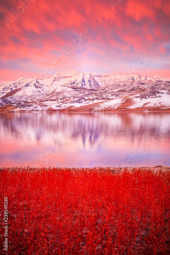 Photo Stands Light pink Vertical red dawn winter reflection in the Wasatch Mountains, Utah, USA.