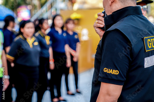 Fotografie, Obraz head of security guard call meeting and talk into walkie talkie for communication to the team