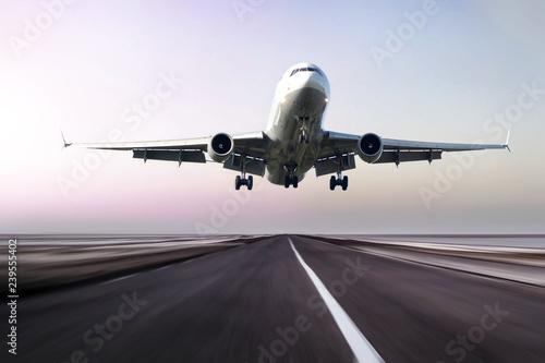 plane takes off at sunrise