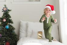 Young Girl Wearing A Santa Hat...
