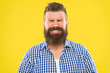 Just sneezed. Man bearded hipster with sneezing face closed eyes close up yellow background. Brutal hipster sneezing. Allergy season concept. Take allergy medications. Can not stop sneezing