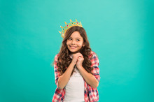 Girl Cute Baby Wear Crown While Stand Blue Background. Become Princess Concept. Every Girl Dreaming To Be Princess. Lady Little Princess. Dreams Come True. Kid Wear Golden Crown Symbol Of Princess