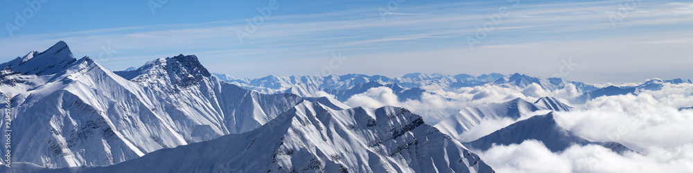 Fototapety, obrazy: Panorama of snowy mountains in clouds