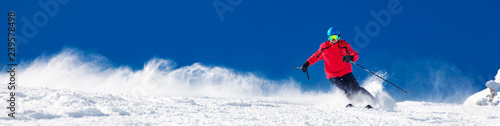 Ingelijste posters Wintersporten Man skiing on the prepared slope with fresh new powder snow