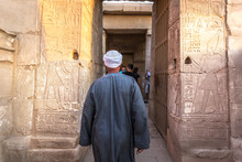 Abu Simbel, Egypt - Nov 5th 2018 - A Local Walking Through A Narrow Temple In Abu Simbel In Egypt
