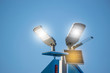Solar panel with lamp under blue sky for energy power concept.