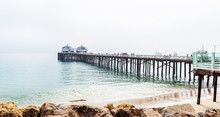 Malibu Foggy Pier In Southern California, Pacific Coast, USA. View On The Pacific Ocean. Copy Space For Text.