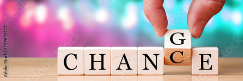 Photo  Hand Changing Word From Chance To Change On Wooden Cubes, New Years Resolution /