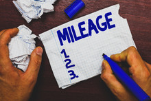 Handwriting Text Writing Mileage. Concept Meaning Number Of Miles Travelled Or Covered Display Panel Car Instrument Man Holding Marker Notebook Page Crumpled Papers Several Tries Mistakes