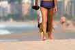 Legs of senior man with swimsuit walking on Copacabana beach in Rio de Janeiro (Brazil)