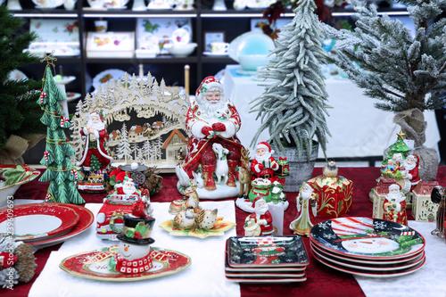 Fotografie, Obraz  Colorful Christmas Souvenirs, decorative statues of Santa Claus, snowman, plates