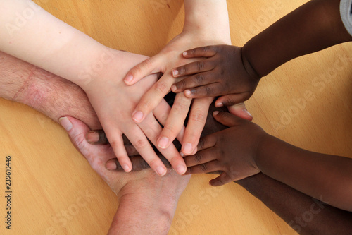 Valokuva  Hands depicting racial harmony.