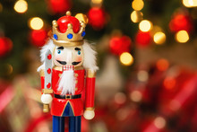 Christmas Nutcracker With Christmas Tree Bokeh Background.