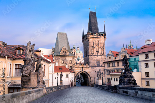 Charles Bridge in Prague in the twilight evening. View of Malostranska Tower and Judithin Tower.
