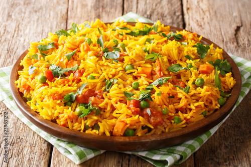 Delicious Indian food Mumbai style rice with vegetables close-up on a plate. horizontal
