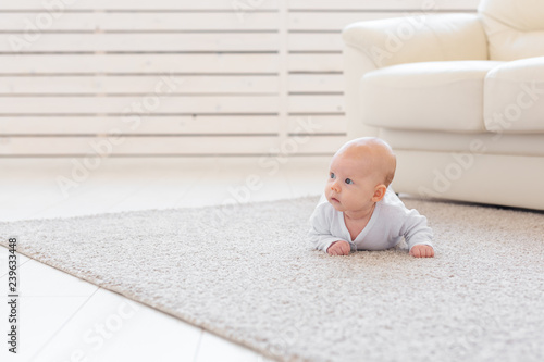Child, childhood and infant concept - Pretty baby lie on the floor Canvas Print