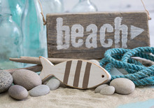 Nautical Still Life With Wooden Beach Sign, Fish, Rope And Old Blue Bottles