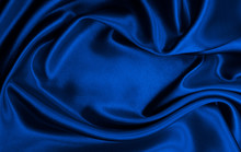 Smooth Elegant Blue Silk Or Satin Luxury Cloth Texture As Abstract Background. Luxurious Christmas Background Or New Year Background Design