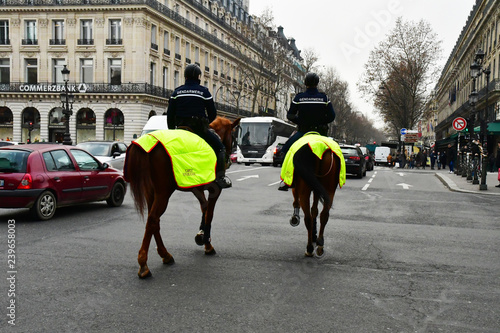 Leinwand Poster Paris; France - december 2017 : mounted police in Opera district