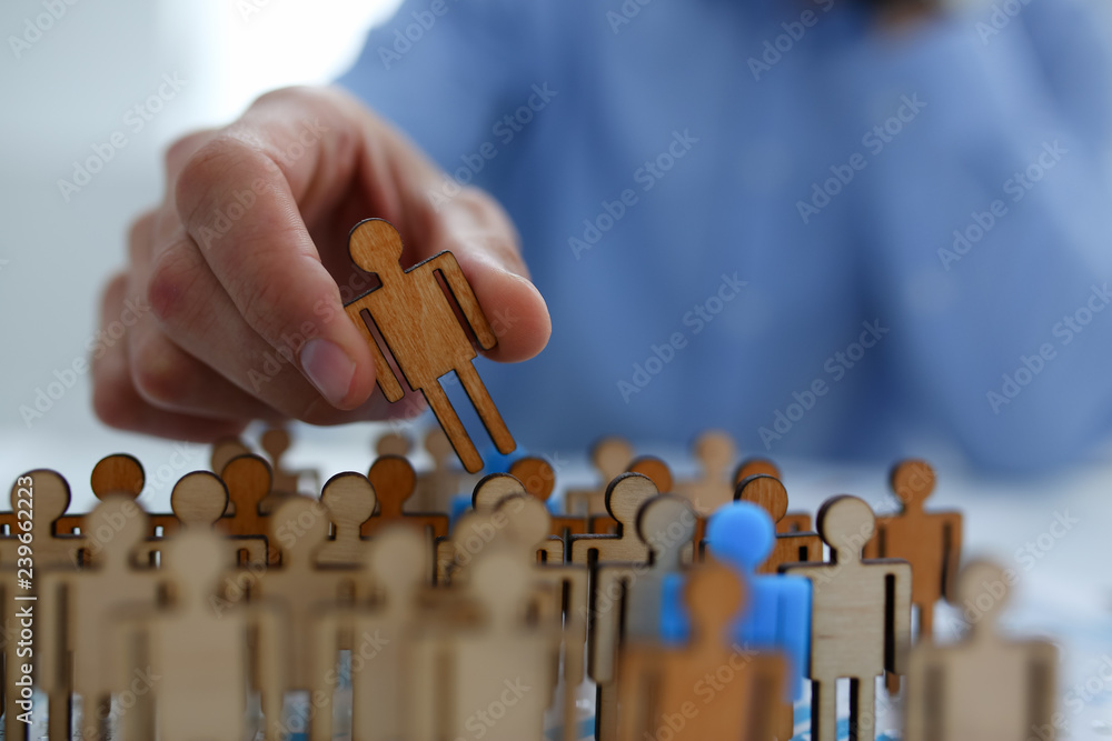 Fototapeta Businessman in blue shirt is holding a magnifying