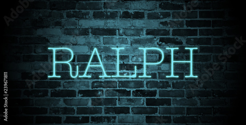 Photo  first name Ralph in blue neon on brick wall