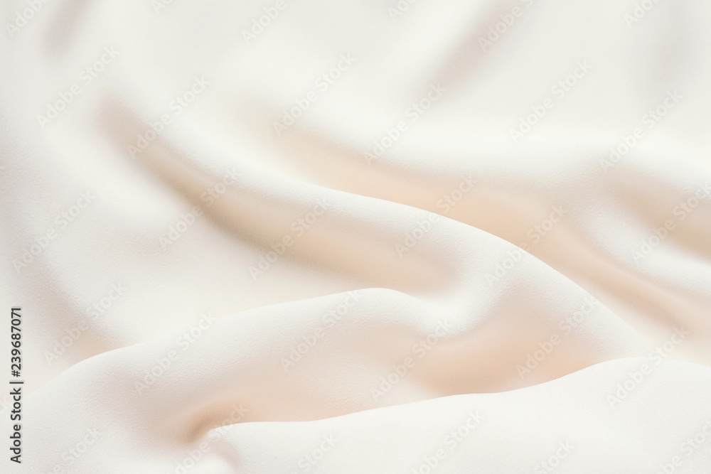Fototapeta Matte cream delicate soft pleated fabric background. Smooth elegant luxury cloth texture. Gentle pastel color wedding background