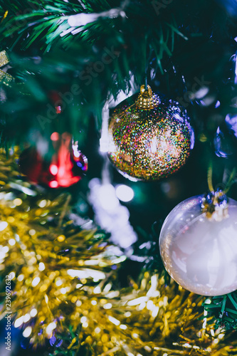Christmas tree decorations and baubles with golden tones Canvas Print
