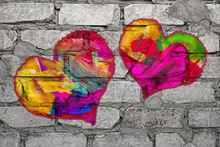 Multi Colored Heart Painted On Gray Brick Wall