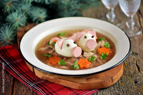 Aspic with meat, pork jelly is a festive traditional Russian dish decorated with boiled eggs in the form of cute pigs Wallpaper Mural