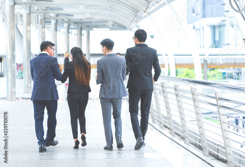 Fotografie, Obraz  Smart business people team or colleagues talking together while walking to meeting Entrepreneurs