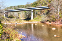 Williams River In Autumn With Stones, Bridge And Highland Scenic Highway Road In West Virginia, WV Low Angle, Monongahela National Forest