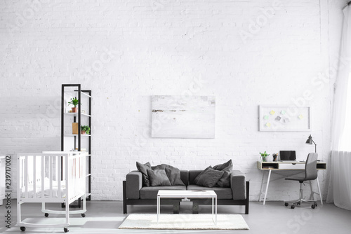 Modern Interior Of Living Room With Baby Crib And Sofa Buy This