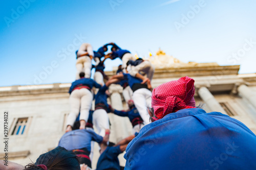 traditional catalan human towers known as castells are built by children castellers in front of generalitat palace