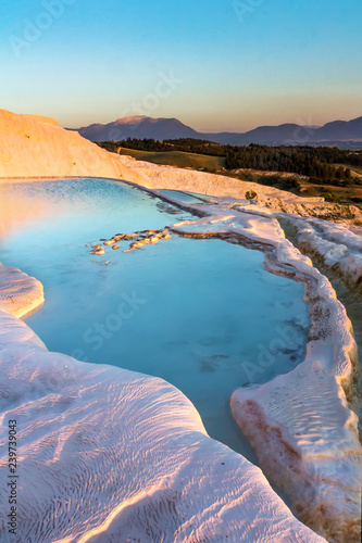 Aluminium Prints Turkey Pools of Pamukkale in Turkey in sunset, contains hot springs and travertines, terraces of carbonate minerals left by the flowing water, UNESCO World Heritage Site