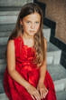 Portrait of young girl model wearing red dress