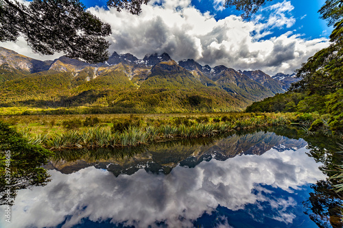 Staande foto Oceanië New Zealand. South Island, Fiordland region. Mirror Lakes - the Earl Mountains reflected in the water