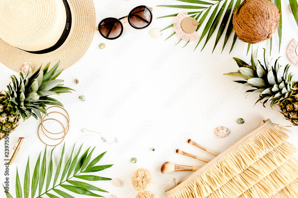 Fototapeta Female, summer street style. Women's frame of accessories. Straw hat, bag, sunglasses and pineapple. Top view, flat lay.