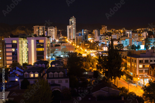Fotografie, Obraz  Dark night over the south area of La Paz, Bolivia. Bright lights
