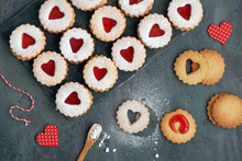 Top View Of Traditional Linzer Cookies With Red Jam Heart On Dark Background