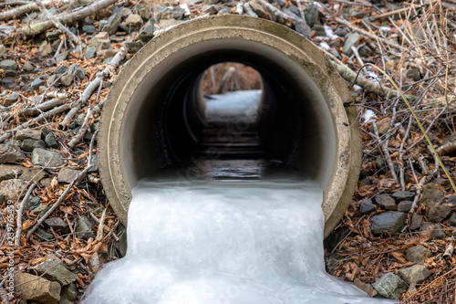 Vászonkép Looking into a frozen culvert